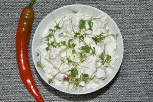 Pikanter Kräuterquark mit Peperoni und frisch geschnittener Gartenkresse.